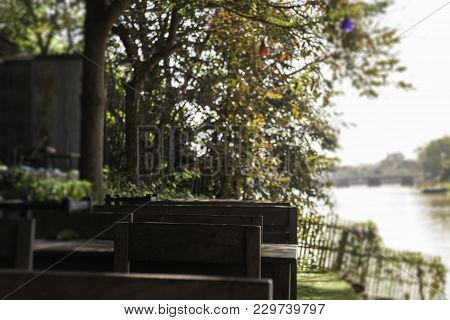 Outdoor Garden With Wooden Set Of Furniture, Stock Photo