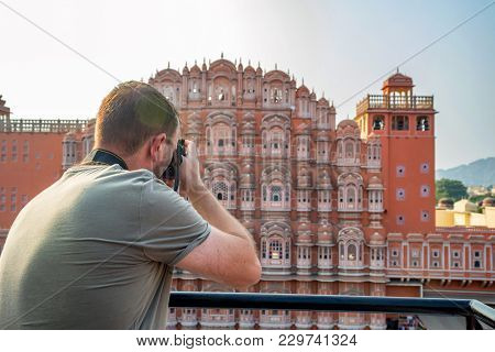 Back View Of Male Traveler Taking Camera Picture Of Hawa Mahal In Jaipur, Rajastan. Travel Concept I