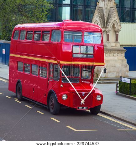 LONDON - APRIL 17: Red Double Decker Bus on the Canon street in London on April 17, 2016 in London, UK. The dobledecker bus is one of the most iconic symbol of London.