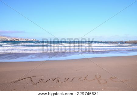 Word Written On The Sand Of A Tropical Beach