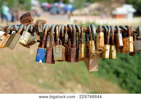 Row Of Old Rusty Lock On The Sling Wire On Believe Of Forever Love