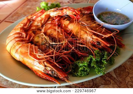 Grilled Giant Tiger Prawns Served With Spicy And Sour Seafood Sauce