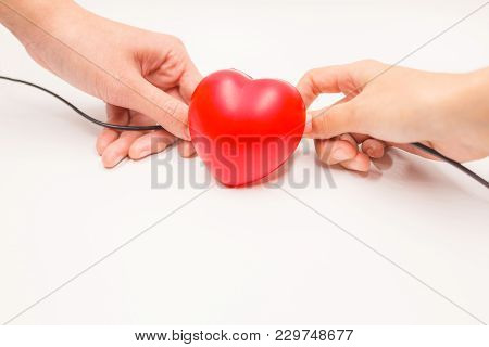 Hands With Charging Cables To Help Recovering Heart On White Background. Heart Disease Protection, P
