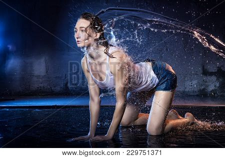 Girl With Long Hair During Photoshoot With Water In Photo Studio And Drops Of Rain Behind Her