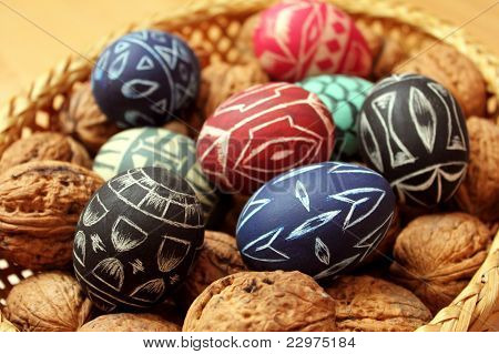easter eggs and walnuts in basket