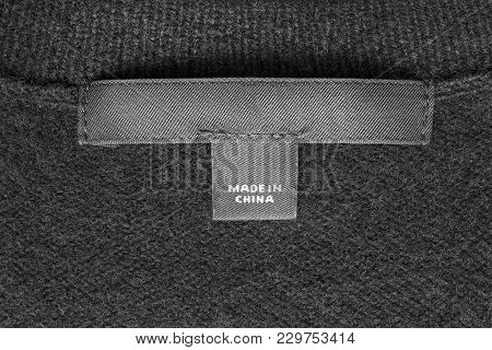 Clothes Label Lettered Made In China On Black Textile Background Closeup