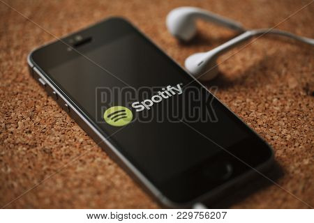 Malaga, Spain - March 5, 2018: Detail Of Mobile Phone With Spotify Logo In The Screen And White Earp