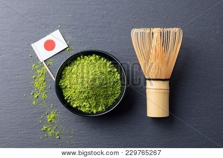 Matcha, Green Tea Powder With Bamboo Whisk And Japanese Flag On Slate Background. Top View