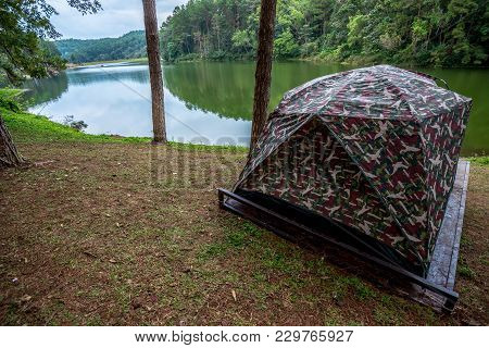 Tent For Camping On Grass In A Hill Near River, Traveling In Thailand