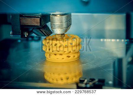 3d Printer Prints Yellow Form Figure Close. Automatic Three Dimensional 3d Printer Performs Plastic
