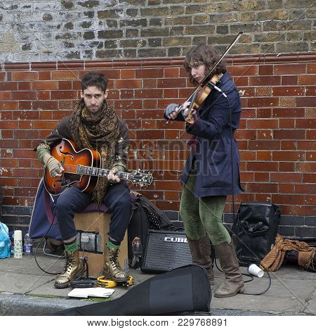 London, Uk - April 22, 2016: Street Musician Play Electric Guitar Near Columbia Road Flower Market.
