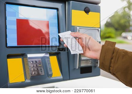 Self-service Filling Station. The Man Is Holding A Receipt In His Hand.