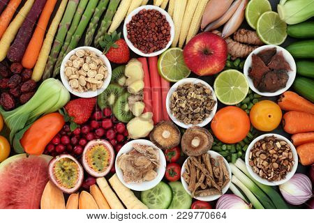 Super food for good health concept with fresh fruit and vegetables and chinese herbal medicine selection with foods high in anthocyanins, antioxidants, vitamins, minerals and dietary fibre. Top view.