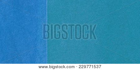 Blue Playground Or Sports Ground Rubber Crumb Cover Grunge Background.