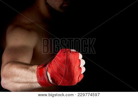 Close Up Low Key Portrait Of A Aggressive Muscular Fighter, Getting Ready For Combat, Wearing Red Bo