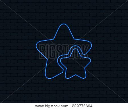 Neon Light. Star Icon. Favorite Sign. Best Rated Symbol. Glowing Graphic Design. Brick Wall. Vector