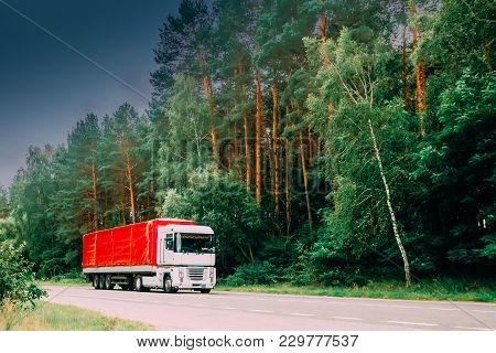 Truck, Tractor Unit, Prime Mover, Traction Unit In Motion On Country Road, Freeway In Europe. Asphal