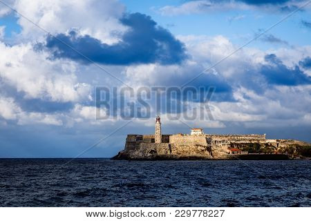 El Morro Spanish Fortress Walls With Lighthouse With Sea In The Foreground And Clouds Above, Havana,