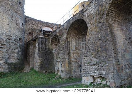 The Bridge And The Walls Of The Ancient Medieval Fortress. The Fortress In Koporye Was Founded In 12