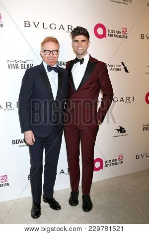 LOS ANGELES - MAR 4:  Jesse Tyler Ferguson, Justin Mikita at the 2018 Elton John AIDS Foundation Oscar Viewing Party at the West Hollywood Park on March 4, 2018 in West Hollywood, CA