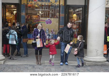 Happy Family With Two Children Out Of The Children's Store