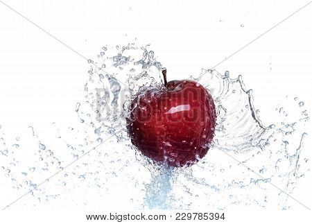 Splash Of Water On A Red Apple. On A White Background.