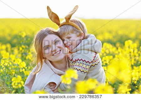 Little Child And His Mother In Easter Bunny Ears Having Fun, Celebrating Traditional Easter Holiday.