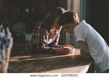 Young Lesbian Couple Spending Time Together On Kitchen In Morning