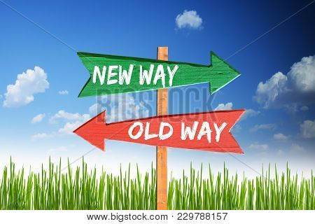 New Way Vs Old Way On Wooden Arrows With Blue Sky As Background