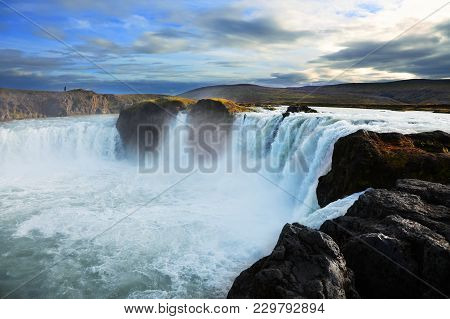 Godafoss Waterfall At Sunset In Iceland