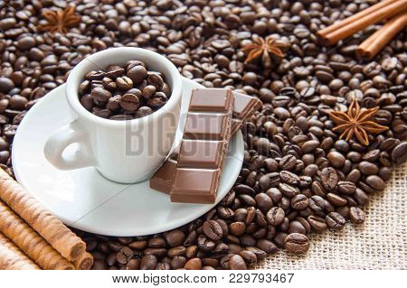 Fried Grains Of Coffee With A Cup On A Silver Platter With Chocolate And Biscuits In A Cup Of Coffee