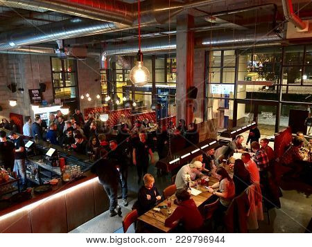 EDINBURGH - MARCH 3, 2018: Customers eat and drink inside Brewdog Lothian Road craft beer bar in Edinburgh, Scotland, UK.