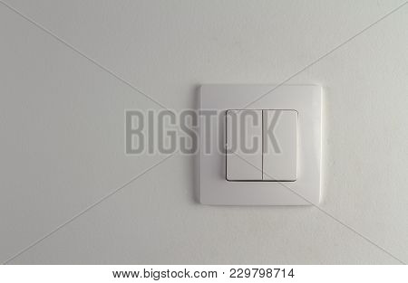 Double White Light Switch On White Wallpaper - Energy Conservation Concept