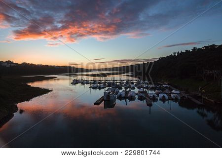 Scenic River Lagoon Water Boats Moorings Mirror Reflections At Sunset Sundown Contrasted Beautiful L