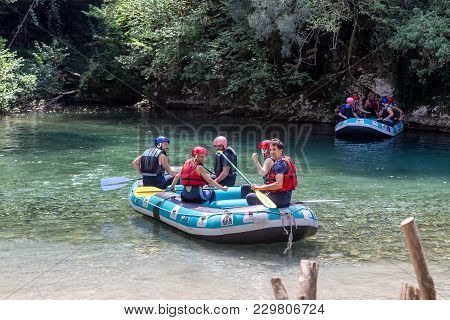 Adventure Team Doing Rafting On The Cold Waters Of The Voidomatis River In Zagori. Voidomatis River