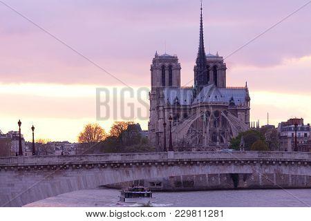Notre Dame Cathedral On Ile De La Cite And Pont De La Tournelle Over Seine River, Paris, France