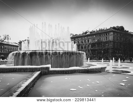 Fountain In Front Of Sforza Castle, Italian: Castello Sforzesco, Is In Milan, Northern Italy. It Was