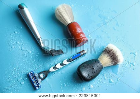 Shaving brushes and razors for man on color background