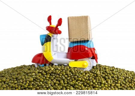 Express Delivery Service By Motorcycle.colorful Motorcycle With Delivery Boxes On Pile Mung Beans On
