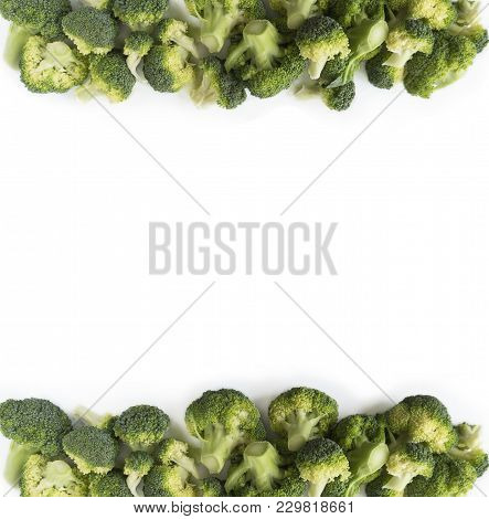Broccoli At Border Of Image With Copy Space For Text. Broccoli Isolated On A White Background. Brocc