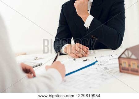 Conclusion Of A Contract For The Purchase Of Real Estate With A Realtor. Close-up Photo Of Contract