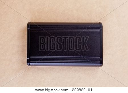 Top View Of External Computer Hard Disk Drive On Beige Background