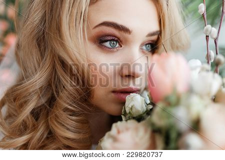Tender Young Woman Face In Flowers. Perfect Skin, Professional Make-up