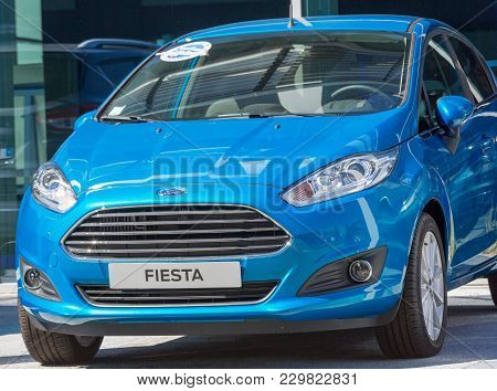 Puilboreau, France - August 7, 2016 : Closeup Of Blue Ford Fiesta Name Plate And Car Outsode Showroo