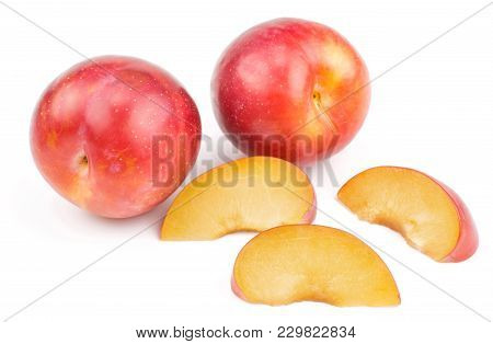 Two Plums Red Orange With Three Slices Isolated On White Background