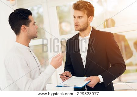 The Guy At A Meeting With A Realtor. The Realtor Is Discussing With The Client The Conditions For Bu