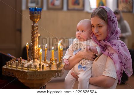 Belarus, Gomel, February 24, 2018. Church Of The Birches.the Baptism Of A Child.mother With Child In