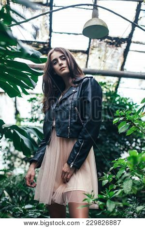 Fashion Portrait Of Young Stylish Woman In Pink Dress And Leather Jacket