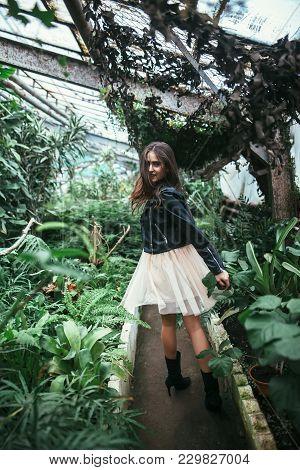 Fashion Portrait Of Beautiful Stylish Girl In Motion Posing On Nature Background