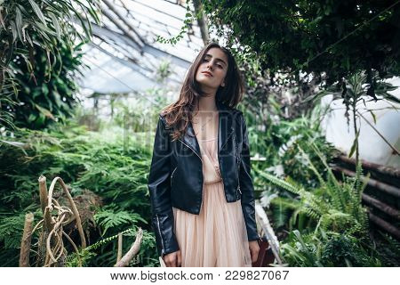 Beautiful Dreaming Woman With Closed Eyes Posing In Garden Greenhouse Background
